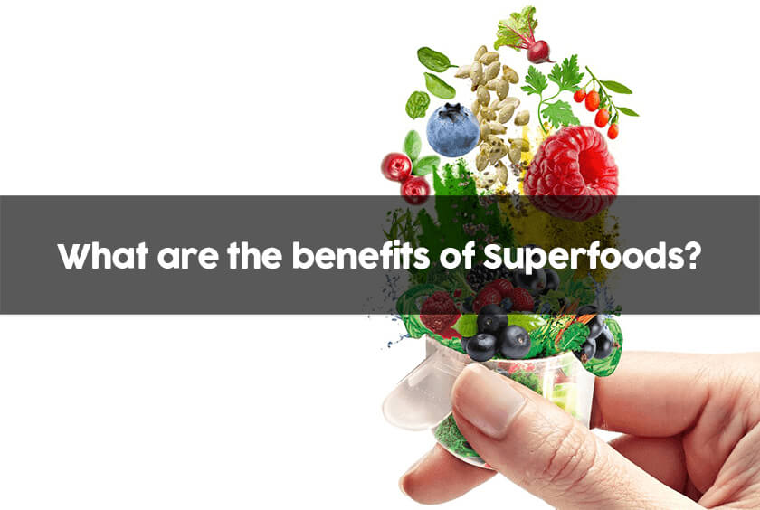 a hand holding its scoop with a variety of over 35 superfoods ready to be mixed in water or your favorite smoothie to get all the benefits of superfoods