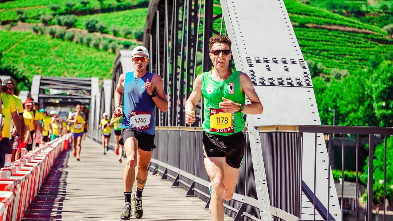 A father with healthy habits including drinking PhytoFood every morning, is running a marathon.